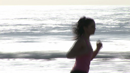 Woman on Beach Jogging Footage