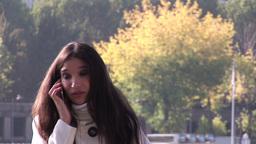 Hispanic woman on phone 2 Live Action