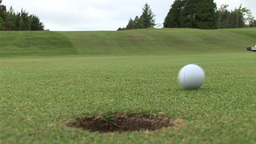 Golf Ball Going into the hole Footage