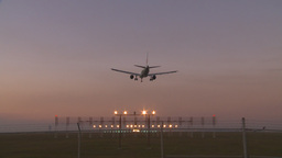 HD2009-9-35-6 jet landing lights fence runway tilt Stock Video Footage