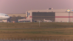 HD2009-9-35-8 A330 taxi past hangar Stock Video Footage