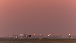 HD2009-9-35-10b A330 take off dusk Stock Video Footage