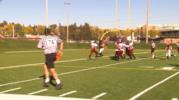 HD2009-9-36-18 high school football huddle pass Stock Video Footage
