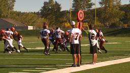 HD2009-9-36-22 high school football huddle huge kickoff... Stock Video Footage