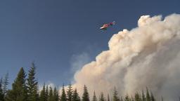 HD2009-9-37-4 Forest fire heavy smoke helo descending Stock Video Footage