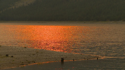 HD2009-9-38-9 smoky red sun reflect on lake Footage