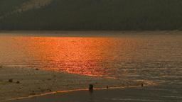 HD2009-9-38-9 smoky red sun reflect on lake Stock Video Footage