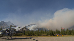 HD2009-9-39-7 forest fire w helo on ground Stock Video Footage