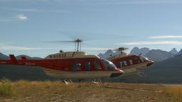 HD2009-9-40-11 heli lands behind helo Stock Video Footage