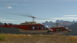 HD2009-9-40-11 heli lands behind helo Stock Video Footage