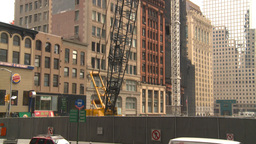 HD2008-8-19-52 NYC construction site crane tilt up Footage
