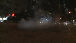 NYC night traffic manhole steam Stock Video Footage
