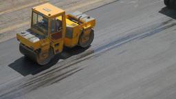 Compactors Flattening Asphalt Footage