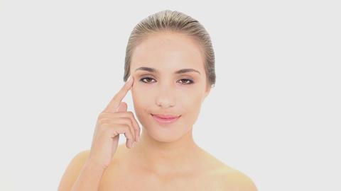 Beautiful model putting face cream on Footage