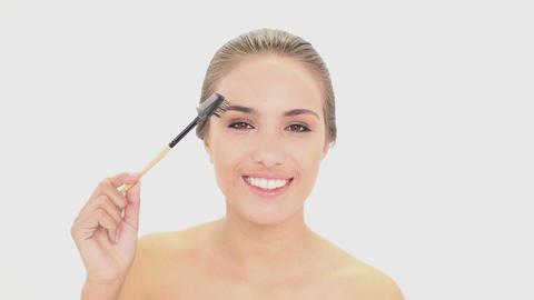 Beautiful model using an eyebrow brush Footage