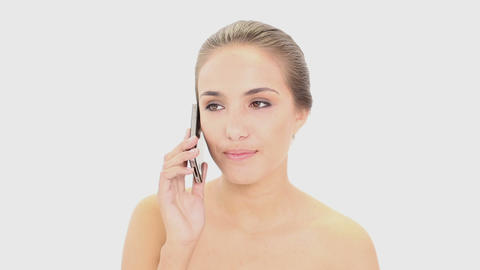 Beautiful model talking on her smartphone Footage