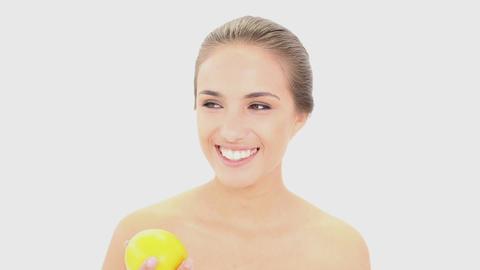 Beautiful model holding an orange Footage