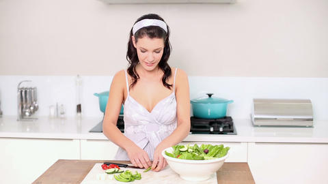 Beautiful brunette preparing a salad Footage