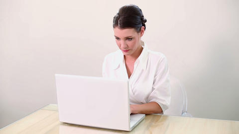 Beautiful brunette using her laptop Footage