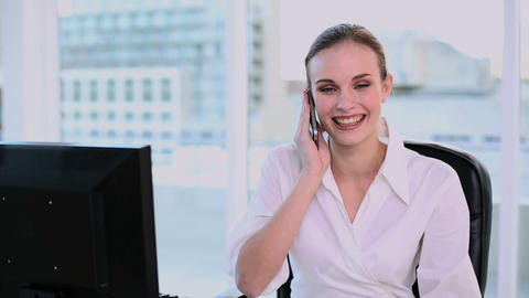 Smiling businesswoman having a phone call Footage