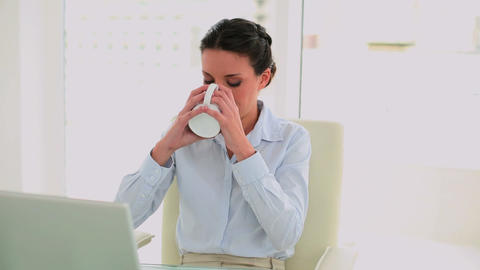 Businesswoman drinking coffee and feeling revitali Footage