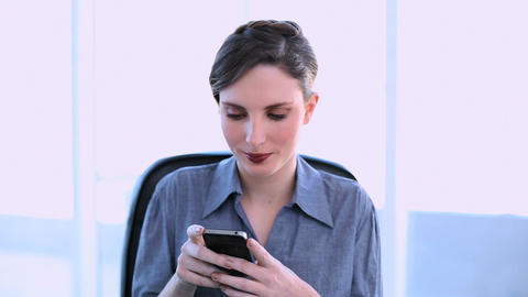 Happy businesswoman texting on her smartphone Footage