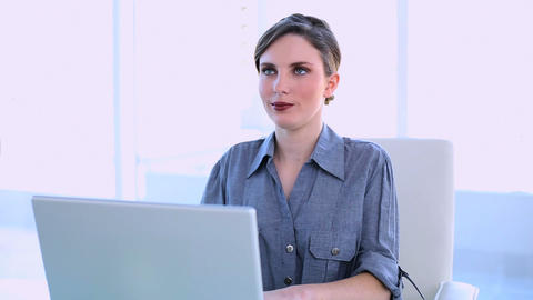 Happy businesswoman working on a laptop Footage