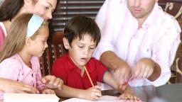 Parents their children doing their homework Footage