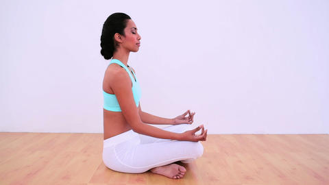 Peaceful woman meditating in lotus position Footage
