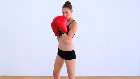 Dynamic woman boxing with red gloves Footage