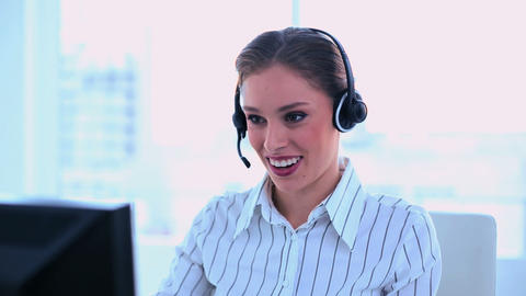 Smiling attractive operator making a phone call Footage