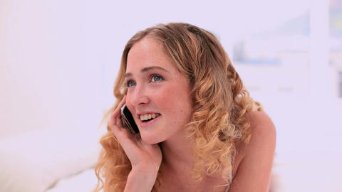 Laughing blonde model making a phone call Footage