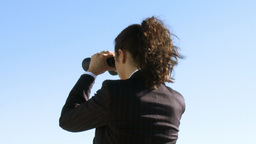 Businesswoman with a binoculars Footage