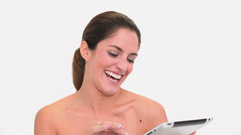 Amused brunette woman using a tablet pc Footage