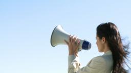 Businesswoman giving instruction via megaphone Footage