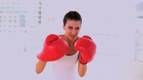 Motivated beautiful woman exercising with boxing g Footage