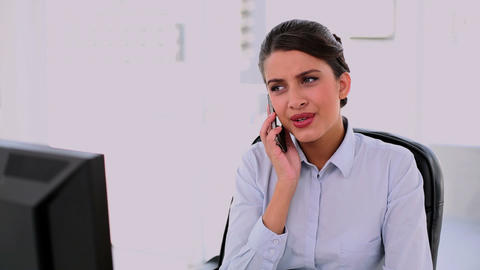 Irritated beautiful businesswoman making a phone c Footage