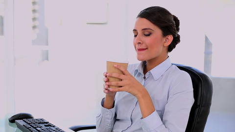 Peaceful beautiful businesswoman enjoying coffee Footage