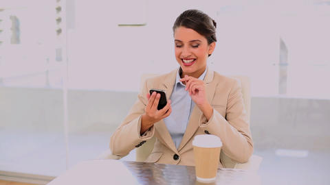 Happy beautiful businesswoman drinking coffee whil Footage