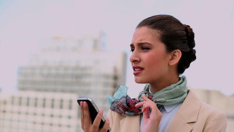 Concentrated Beautiful Woman Using A Mobile Phone stock footage