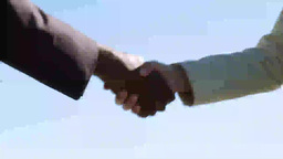 Two businesspeople shaking hands multi cultural Footage