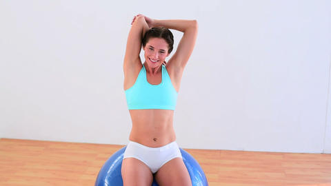 Fit brunette stretching on an exercise ball Footage