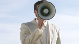 The ultimate businessman with a portable megaphone Footage