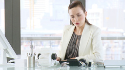 Businesswoman working in her office Footage