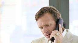 Businessman talking on phone Footage