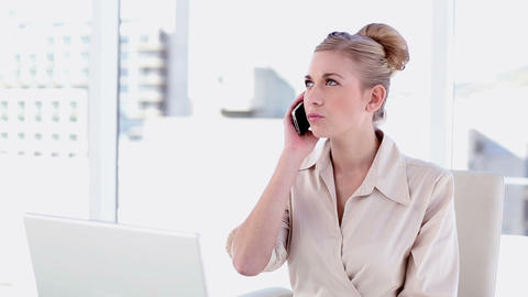 Content blonde businesswoman phoning Footage