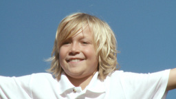 Smiling blond boy Jumping Footage