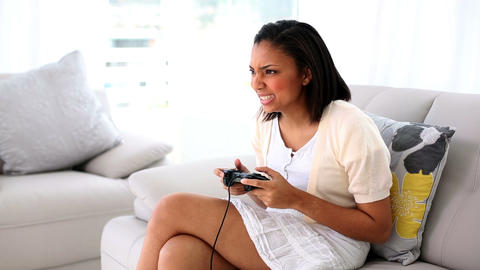 Amused dark haired woman playing a video game Footage