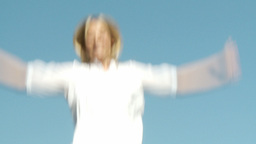 Blonde Woman jumping on a trampoline Footage