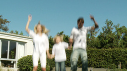 Parents and Child jumping on a trampoline Footage